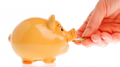 Piggy Bank with money in hand