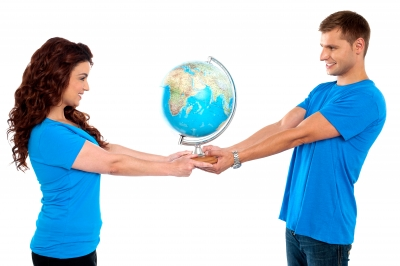 budgeting-couple-with-world-in -their-hands