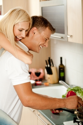 man cooking with woman
